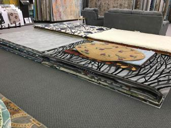 Bandele Abbey Flooring & Rug showroom area rug displays